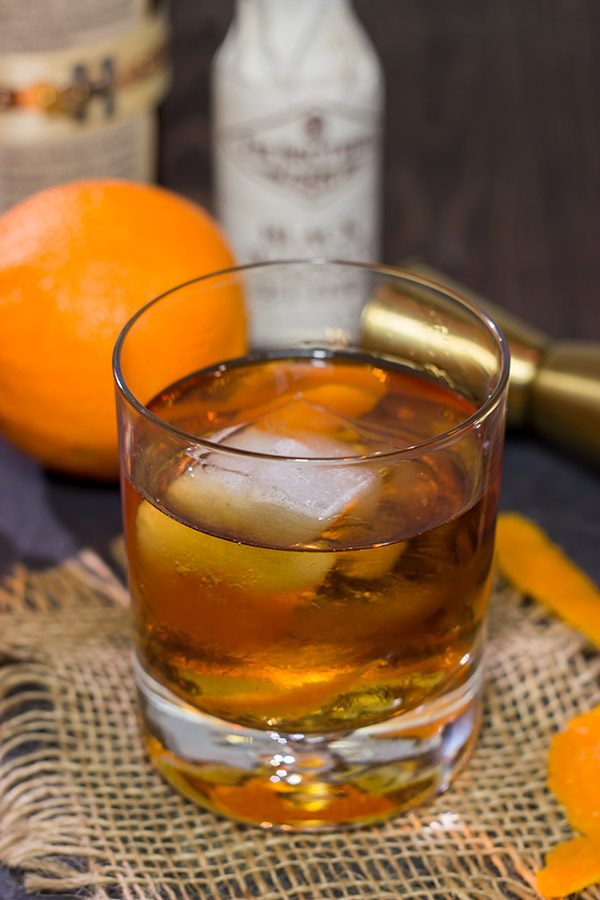 This Smoked Old Fashioned introduces maple syrup and smoke for a fun twist on a classic cocktail!