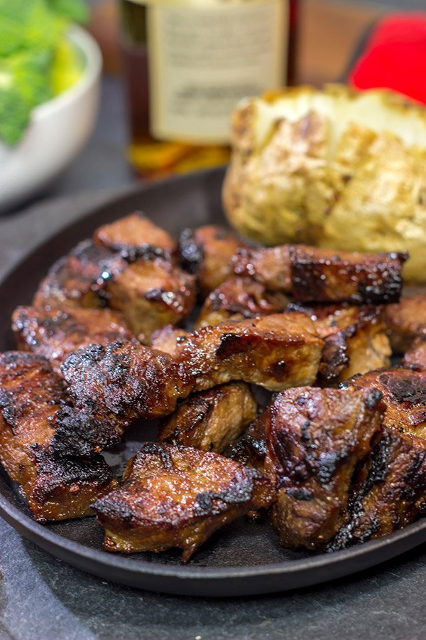 Looking for a fun marinade idea? Pull out the bottle of bourbon! These Bourbon Marinated Steak Tips make for a delicious (and easy) dinner idea!