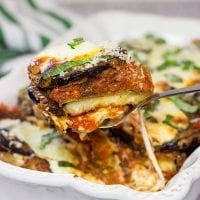 Featuring layers upon layers of flavorful eggplant, fresh mozzarella cheese and tomato sauce, this Eggplant Parmesan is a classic (and delicious) recipe!