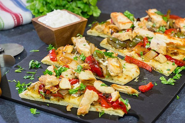 Looking for an easy and delicious dinner for game night? These Chicken Fajita Flatbreads are sure to be a family favorite!
