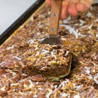 Studded with chopped pecans and shredded coconut, this German Chocolate Slab Pie is a tasty (and easy) way to feed a crowd!