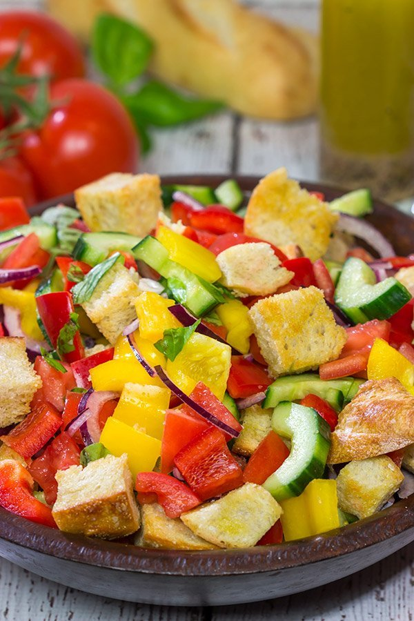 Packed with fresh veggies and perfectly toasted bread cubes, Panzanella is a classic side dish that's great for summer entertaining!