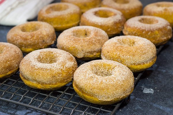 These Baked Pumpkin Spice Donuts are packed with cinnamon and pumpkin...and they're the perfect sweet treat for a chilly Autumn day!