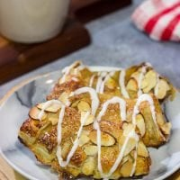 Filled with almond paste and topped with sliced almonds, these Almond Bear Claws are a fun and tasty breakfast treat!