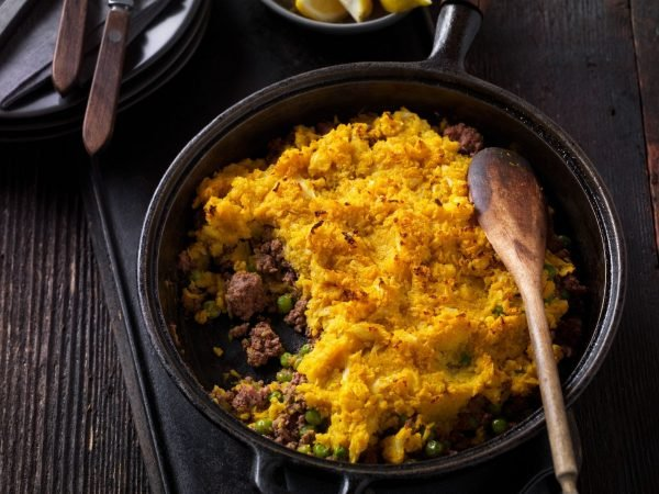This classic Shepherd's Pie dish is reimagined with Ground Beef and warm, exotic spices such as garam masala, turmeric, and ginger, topped with mashed cauliflower.
