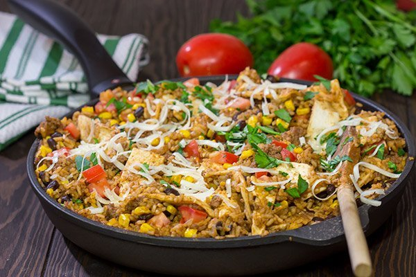 Looking for a fun way to mix up week night dinners? Mix the burritos right into the filling with these tasty Skillet Beef Burritos!