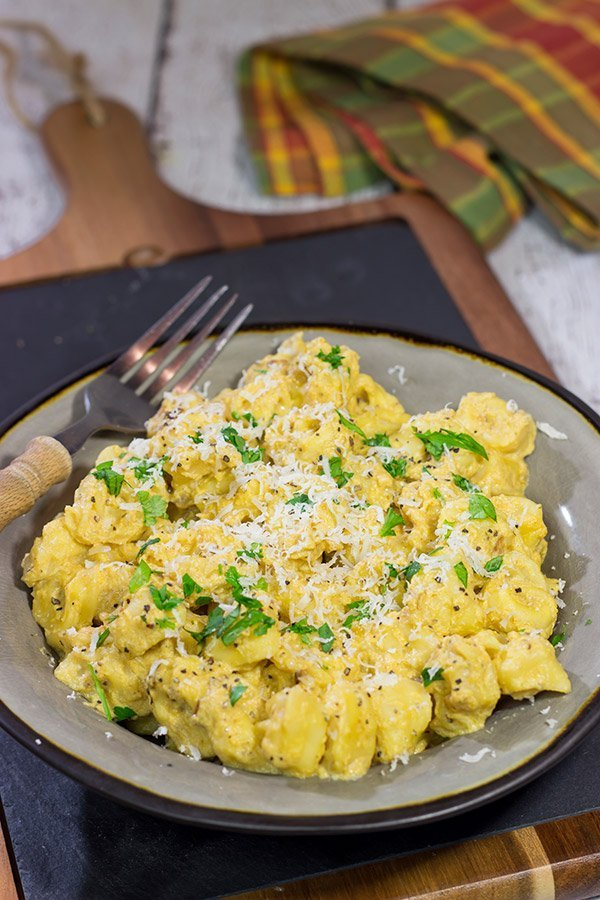 This Tortellini with Pumpkin Alfredo is creamy, delicious and so easy to make for a chilly Fall evening. Make tonight a comfort food night!
