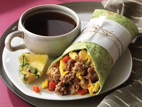 Ground Beef, peppers and onions are quickly sautéed and wrapped up with scrambled eggs. Serve with lime-cilantro cream and salsa.