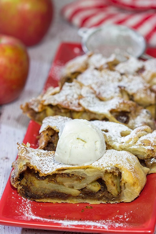 This classic Apple Strudel features crispy pastry dough filled with cinnamon, apples and rum-soaked raisins. It's a delicious way to celebrate apple season!