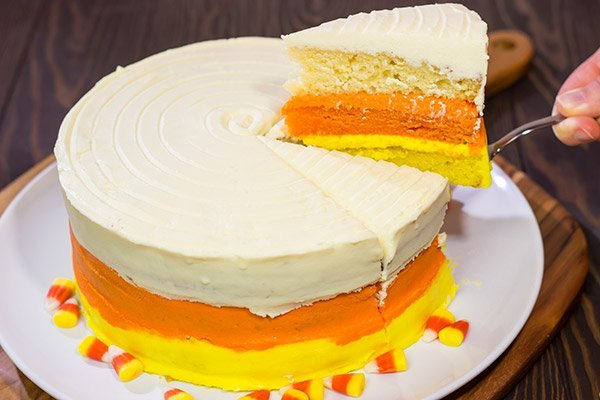 Whether you love or hate actual candy corn, this Candy Corn Cake is a delicious way to celebrate Halloween!  Happy baking!