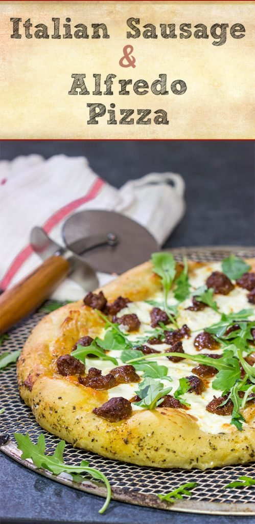 Mix up pizza night! This Italian Sausage and Alfredo Pizza features a delicious alfredo sauce base topped with juicy Italian sausage and fresh arugula!