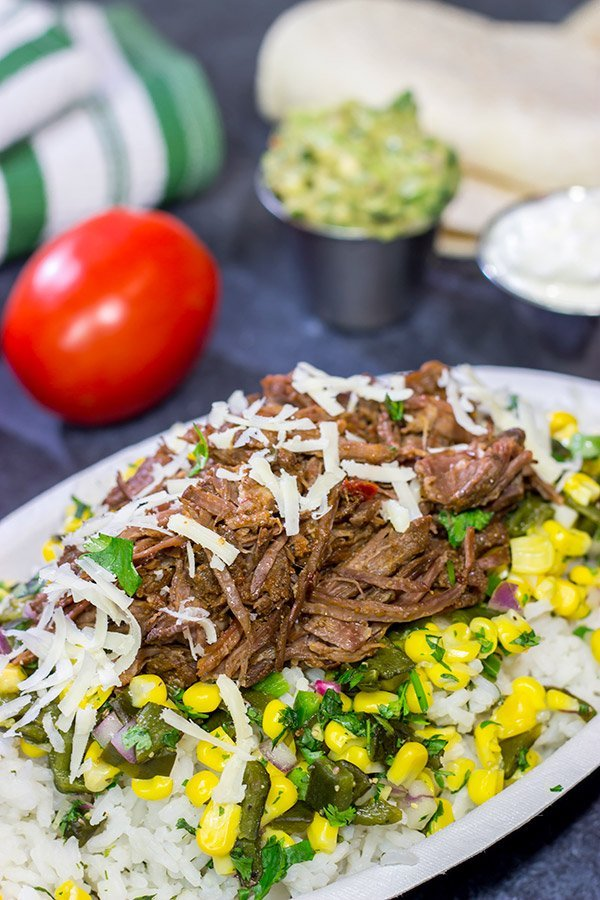 Craving some delicious comfort food? Then put these Slow Cooker Beef Barbacoa Burrito Bowls on the menu!