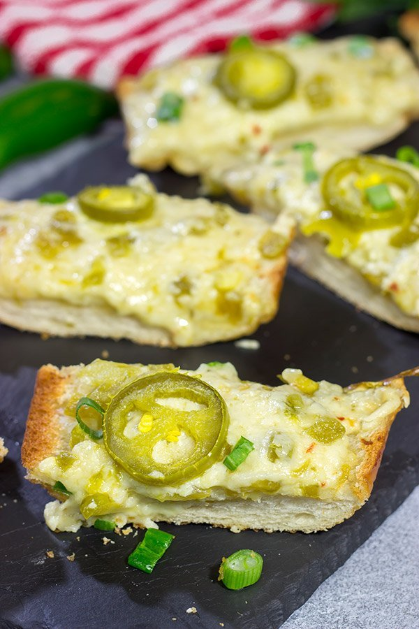 Topped with 2 types of cheese, this Cheesy Jalapeno Garlic Bread makes for a delicious addition to any meal!