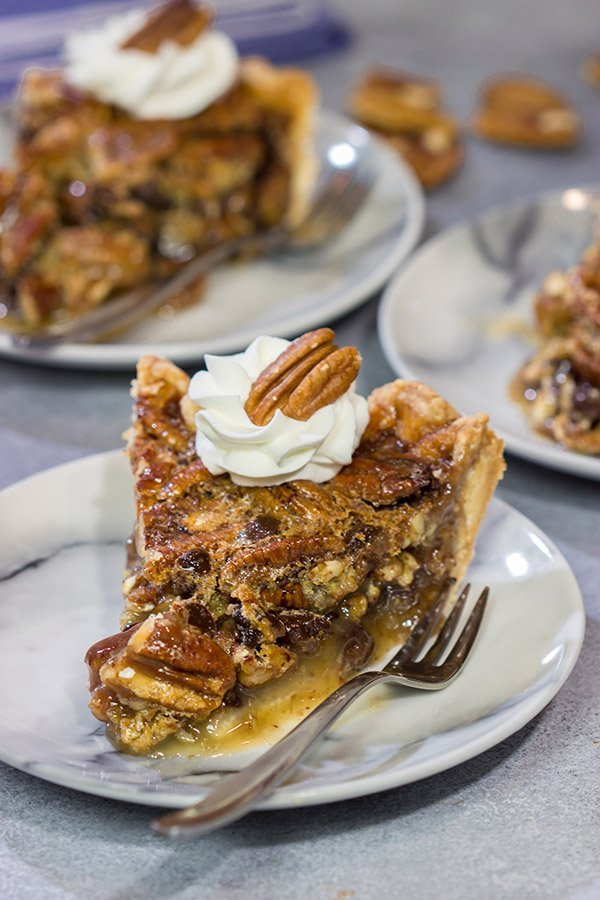 The traditional pecan pie gets a makeover in the form of this Chocolate Bourbon Pecan Pie.  It's a fun and delicious twist on a classic recipe.  Bake one up for dessert today!