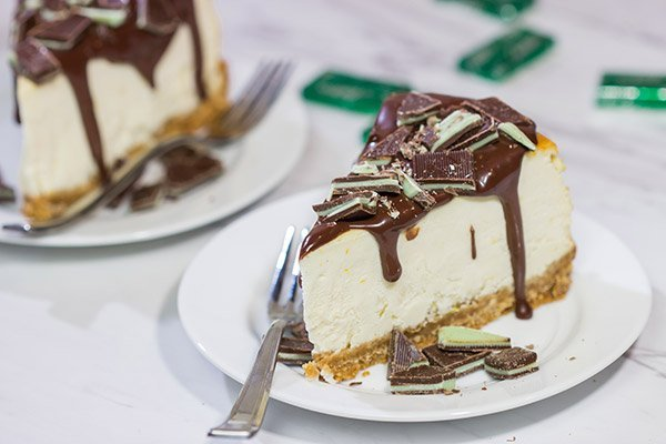 Topped with melted chocolate and chopped Andes mints, this Ricotta Cheesecake with Peppermint Chocolate Sauce is a delicious and fun holiday dessert!