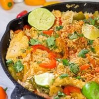 This Chicken Fajita Skillet is packed with flavor! It starts on the stove top and then finishes baking in the oven - this easy one-pan meal is perfect for weeknight cooking!