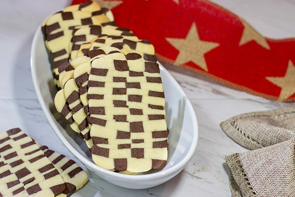 "Featuring a fun ""woven"" look, these Basketweave Cookies are a delicious combination of vanilla and chocolate shortbread cookies.  Bake up a batch today!"
