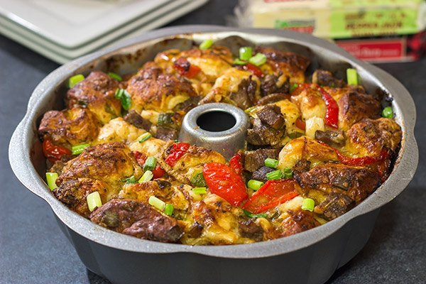 Packed with juicy steak, sauteed peppers + onions and two types of cheese, this Philly Cheesesteak Monkey Bread is one delicious way to mix up the routine!