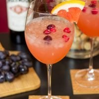 Give your glass of wine an Autumn feel with this Cranberry Grapefruit Wine Spritzer.  It's a tasty way to welcome in sweater season!