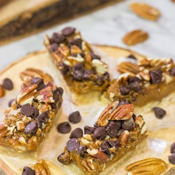 These Dulce de Leche Turtle Cookie Bars feature a shortbread cookie crust topped with dulce de leche, pecans and chocolate chips. Yum!