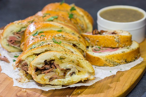 A good French Dip sandwich is hard to beat...unless you stuff it inside of garlic bread! This French Dip Stuffed Garlic Bread is a comfort food favorite!