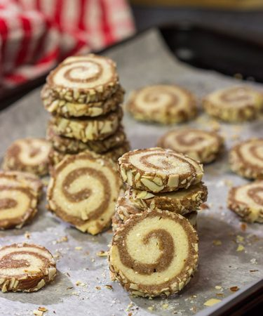 These Chocolate Almond Sugar Cookies have something for everyone!  These swirled chocolate and vanilla cookies get rolled in chopped almonds before going into the oven.  Yum!