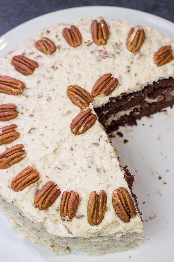 Craving a good slice of cake? Then pull out the pecans and make this Chocolate Pecan Cake! This is a moist chocolate cake covered with pecan frosting...and it's delicious!