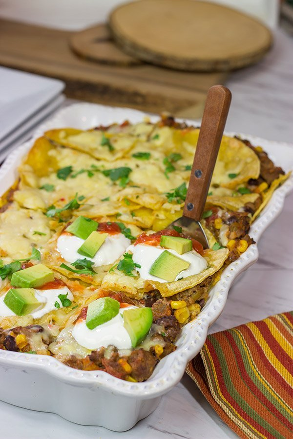 Looking for a fun way to mix up the dinner routine?  This Mexican Lasagna features beef chorizo layered between corn tortillas, refried beans and plenty of melted cheese!