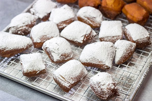New Orleans Beignets are a classic sweet treat in the Crescent City.  Now you can make a batch at home...complete with plenty of powdered sugar!