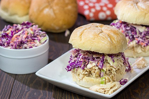 Topped with crunchy coleslaw, these Carolina Style BBQ Shredded Chicken Sandwiches make for a tasty meal!