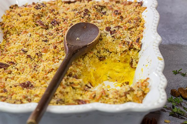 Topped with crunchy pecans, this Cheesy Butternut Squash Casserole is a delicious Autumn side dish. It's now a staple in our house!