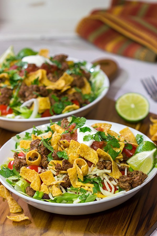 This Ground Beef Taco Salad is easy and delicious! This classic recipe is ready in just 15 minutes...just don't eat all of the Fritos first!