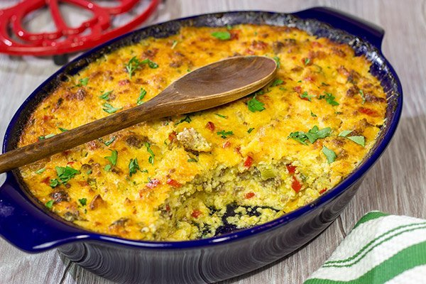 Give grits a chance! Loaded with all sorts of yummy ingredients, this Sausage and Cheese Grits Casserole is a great way to enjoy a lazy brunch or perhaps breakfast for dinner!