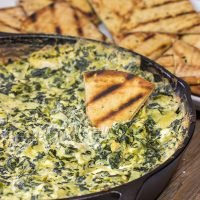 Looking for a fun appetizer recipe with an outdoor smoky twist? Fire up the grill or smoker and make a batch of this Smoked Spinach Artichoke Dip!