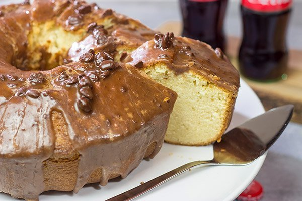 Topped with a chocolate glaze, this Coca Cola Pound Cake is a unique dessert idea! Grab a slice today!