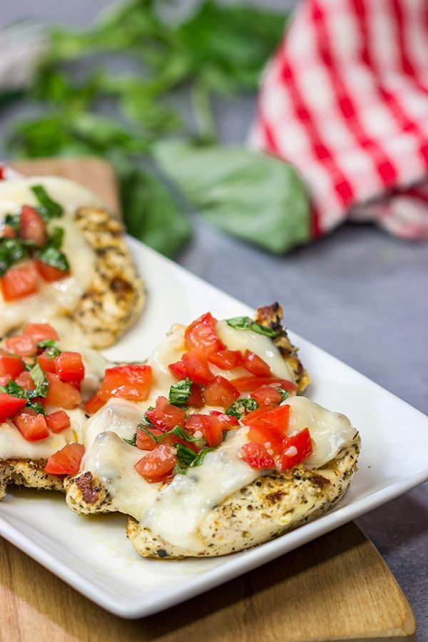 This Grilled Bruschetta Chicken is an easy recipe that's packed with flavor. It's perfect for dinner in the backyard on a warm summer night!
