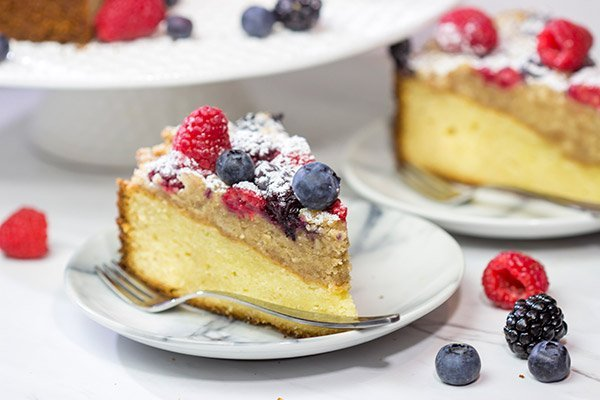 Topped with fresh berries and dusted with powdered sugar, this Mixed Berry Topped Coffee Cake is a great way to celebrate summer berry season!