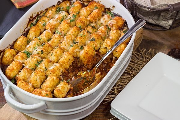 Looking for the ultimate winter comfort food meal? This Tater Tot Chili Casserole starts with a classic ground beef chili...and then gets topped with crispy tots!