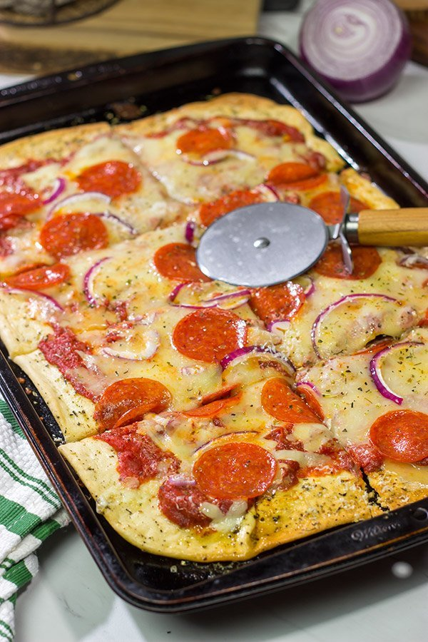 This Pepperoni Pan Pizza features an easy, homemade pizza dough that can be ready in just 20 minutes. Make tonight a pizza night!