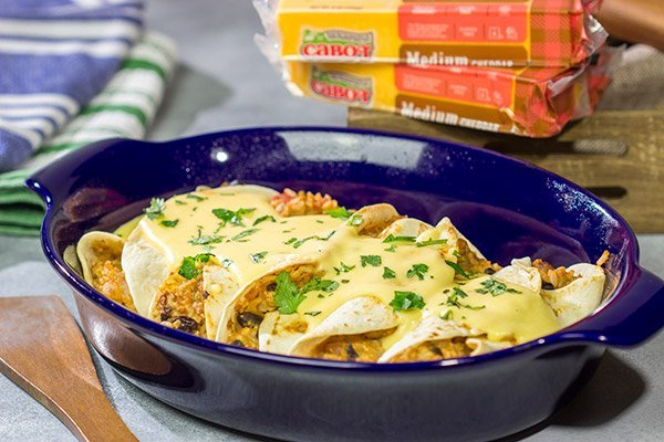Want to break out of the 'dinner rut'?  Then put these Cheesy Baked Burritos on the menu!  Topped with an easy, homemade cheese sauce, these burritos are the perfect comfort food for chilly days!