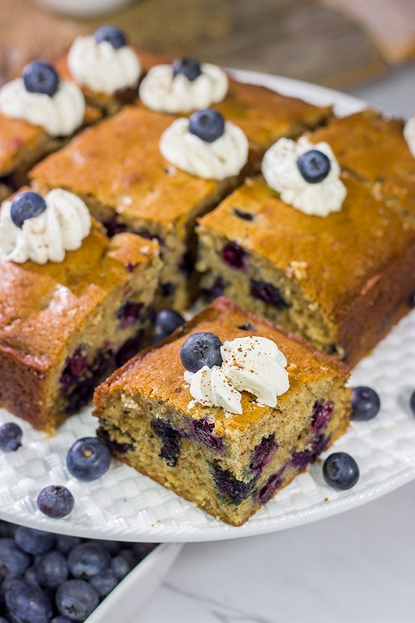 Packed with fresh blueberries and topped with a dollop of ginger whipped cream, this Blueberry Breakfast Cake is a great way to start a summer weekend morning!