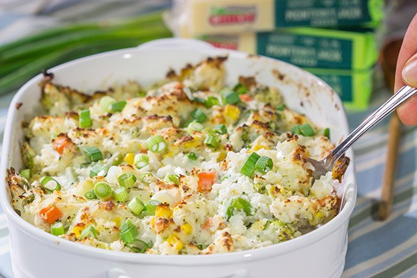 This Cheesy Hash Brown Casserole is a classic Southern recipe - bulked up with veggies and creamy Monterey Jack cheese!  Serve as a side dish or main course!