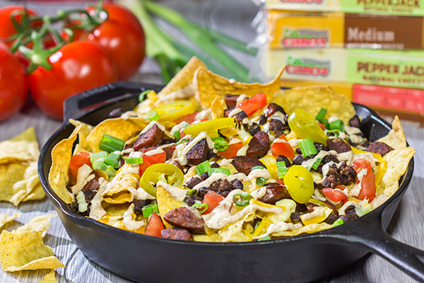 Topped with andouille, Cajun black beans and 2 types of cheese, these Loaded Cajun Nachos make for a delicious appetizer or main course!