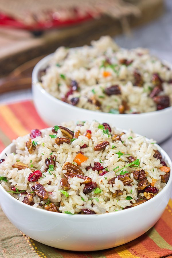 Packed with pecans, dried cranberries and carrots, this Pecan Rice Pilaf is a flavorful side dish for any season!