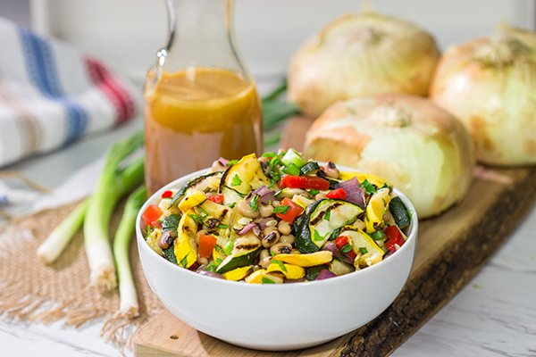 If you're looking for a tasty summer side dish, then look no further! This Vidalia Onion, Bourbon and Sorghum Vinaigrette with Black Eyed Pea Salad is packed with flavor!