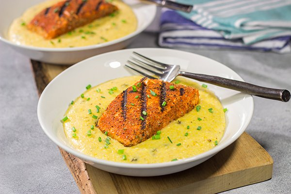 Topped with a flavor-packed piece of Cajun Grilled Salmon, these Cheesy Jalapeno Grits are delicious! These ain't grandma's grits!
