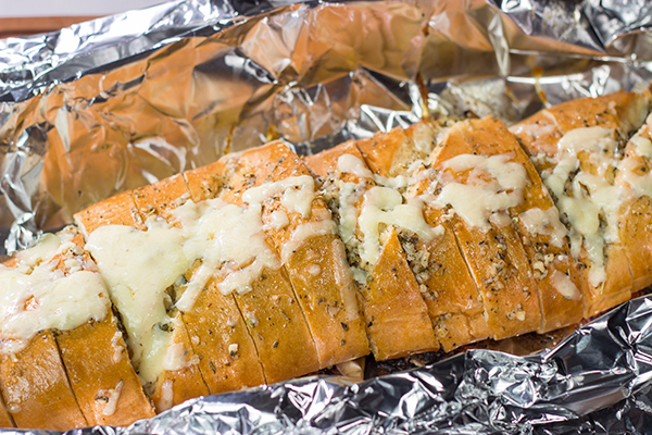 Looking for a fun summer grilling idea? Fire up the grill and put this Cheesy BBQ Steak Stuffed French Bread on the menu!