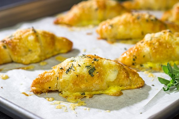 These Cheesy Crescent Rolls feature flaky layers filled with melted cheese...and they can be ready in just 20 minutes!