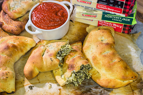 Turn a favorite dip into a meal with a batch of these Spinach Artichoke Calzones!