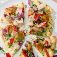 Grilled flatbreads are a fun summer recipe! These Grilled Pork and Pineapple Flatbreads are packed with flavor...serve 'em as an appetizer or a main dish!